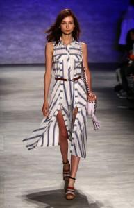 Woman walks down runway with striped dress