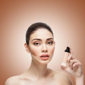 Woman holding foundation with contoured makup