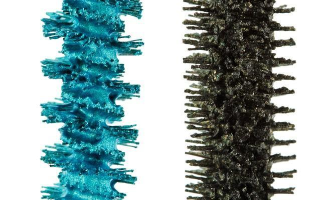 Bright blue and dark green mascara brushes