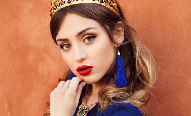 Woman with blue earrings