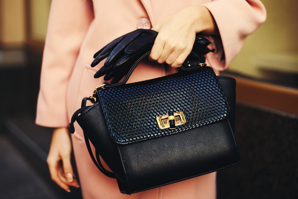 black handbag with gold clasp