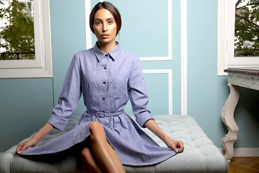 woman in blue button-up dress
