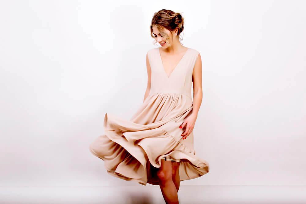 woman in loose, beige dress