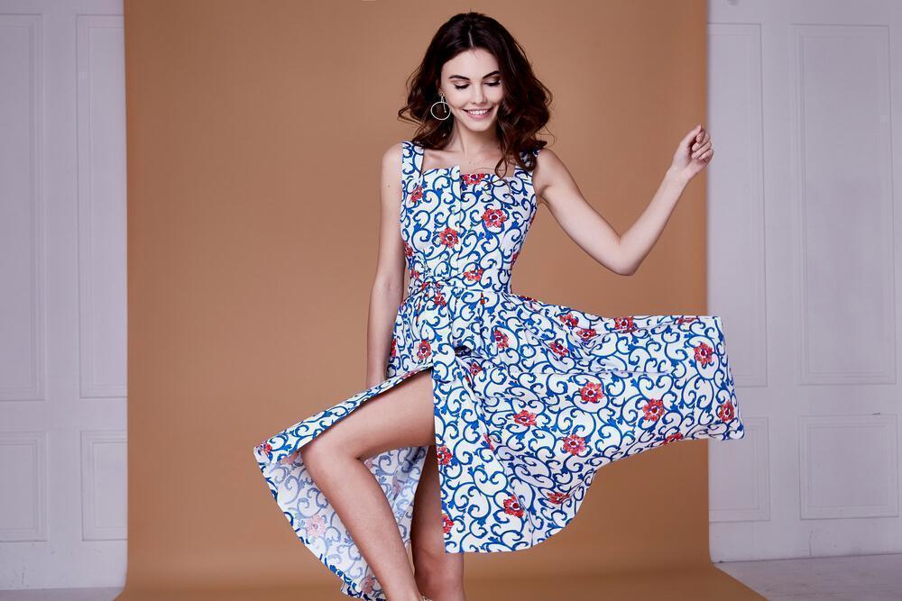 woman in print blue dress