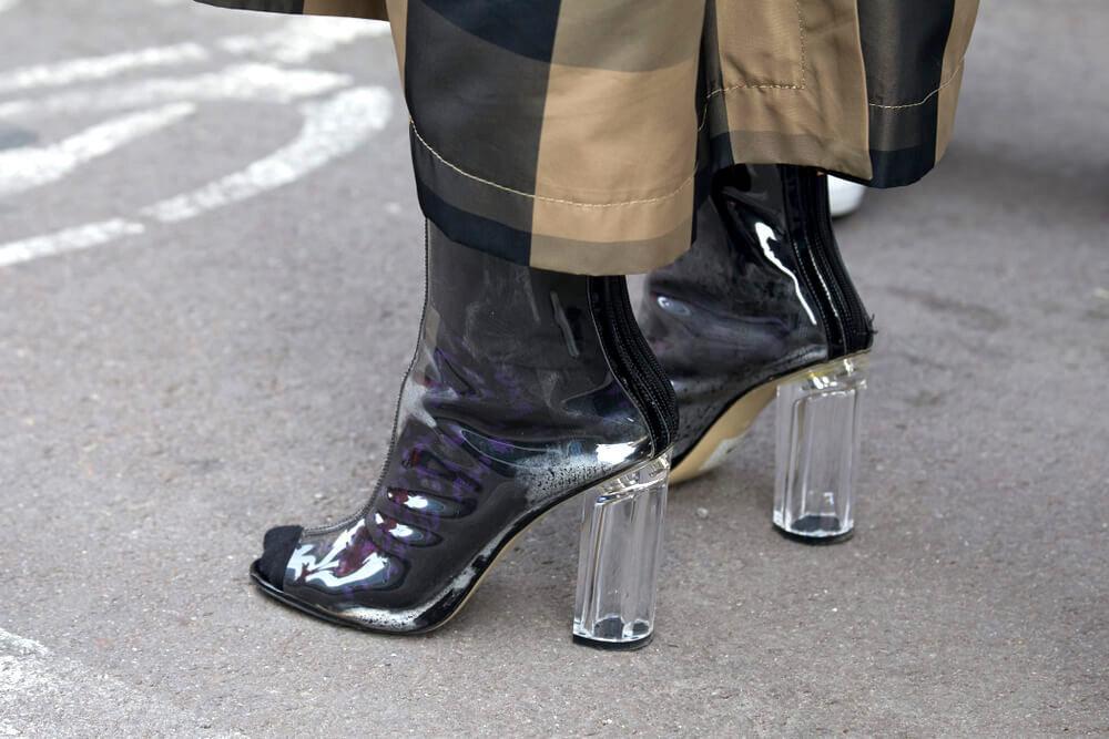 Woman's feet in glass heels