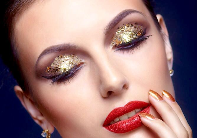 Glitter and gold-leaf eye makeup