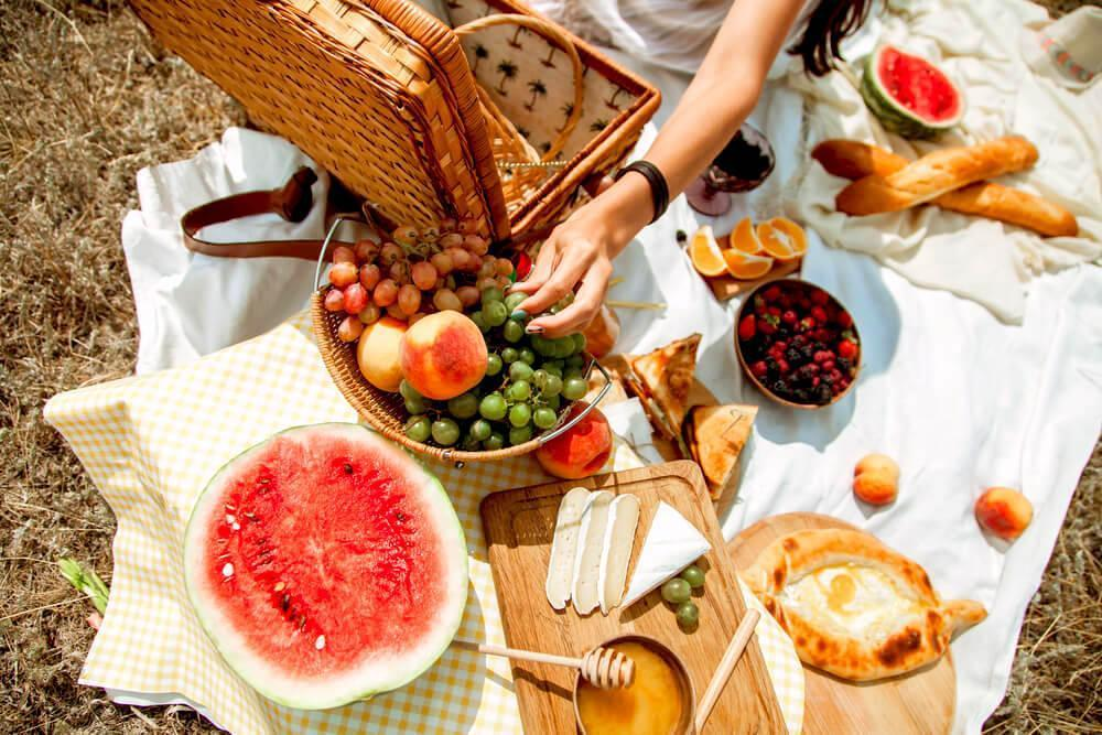 Flat lay of picnic foods outdoors