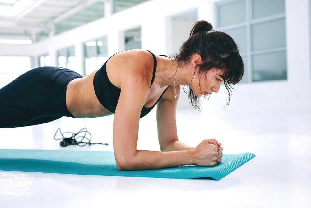 Young athletic woman doing the plank