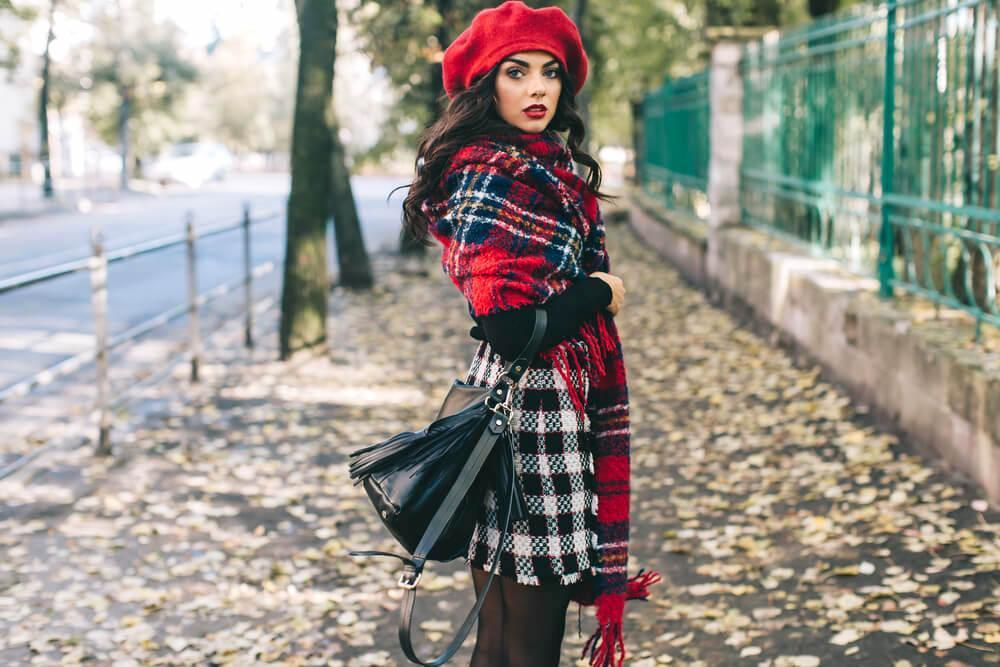 Fashionable woman in red beret and scarf in the street