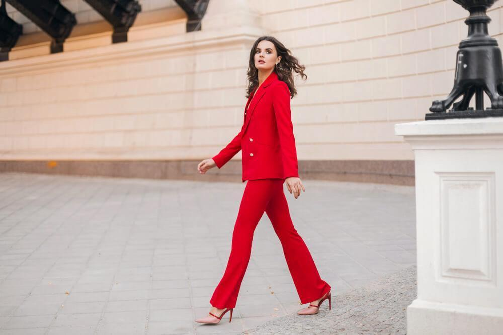 Woman in red tailored suit