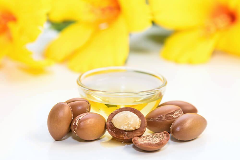 Bowl of argan oil, with argan nuts