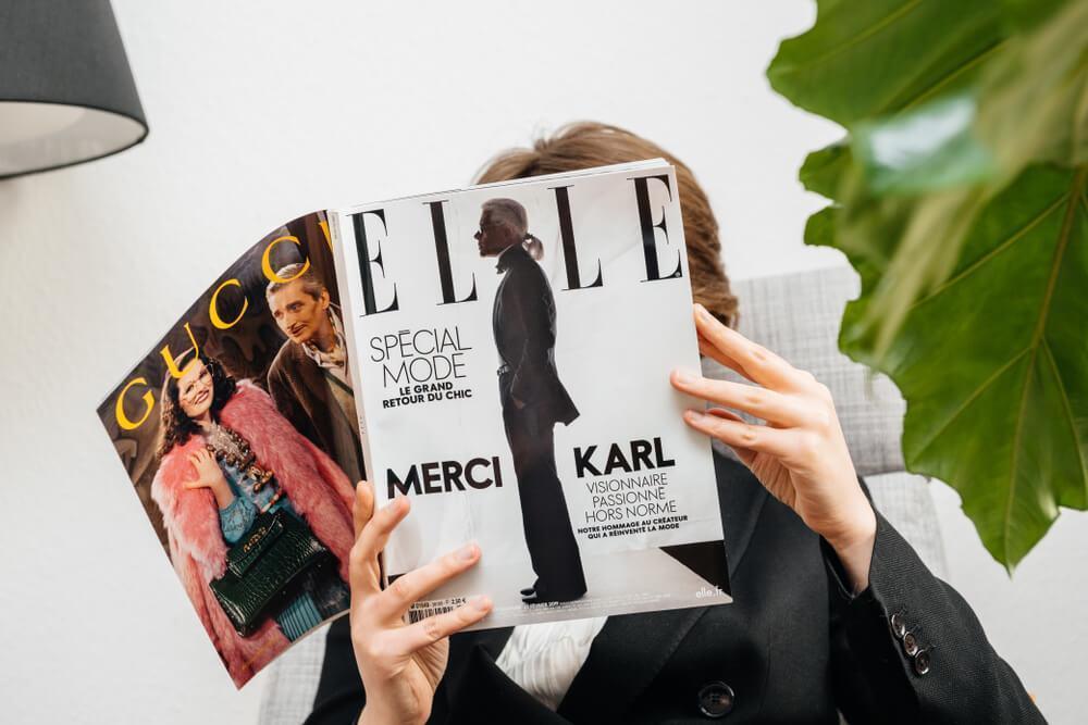 Woman reading Elle Magazine