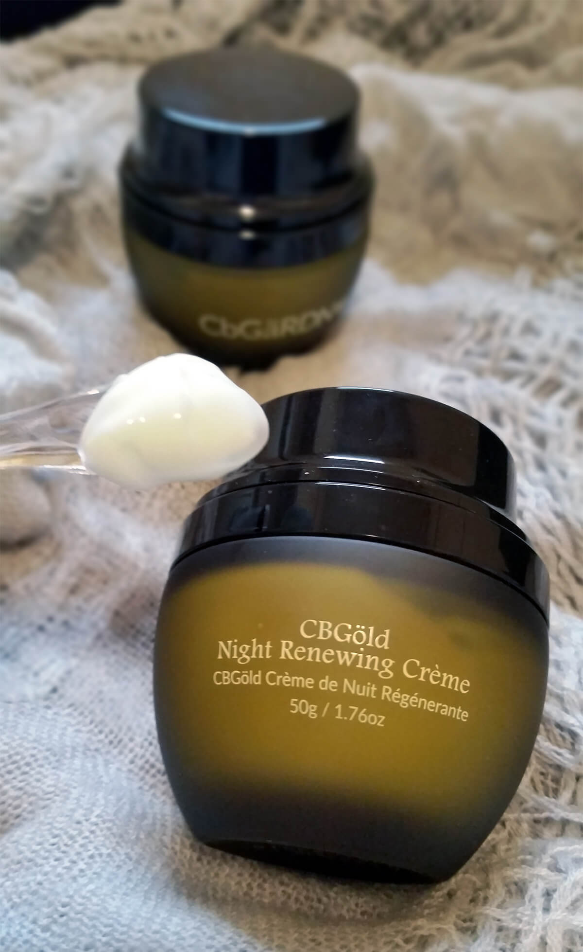 CBGold Night Renewing Creme with product on applicator