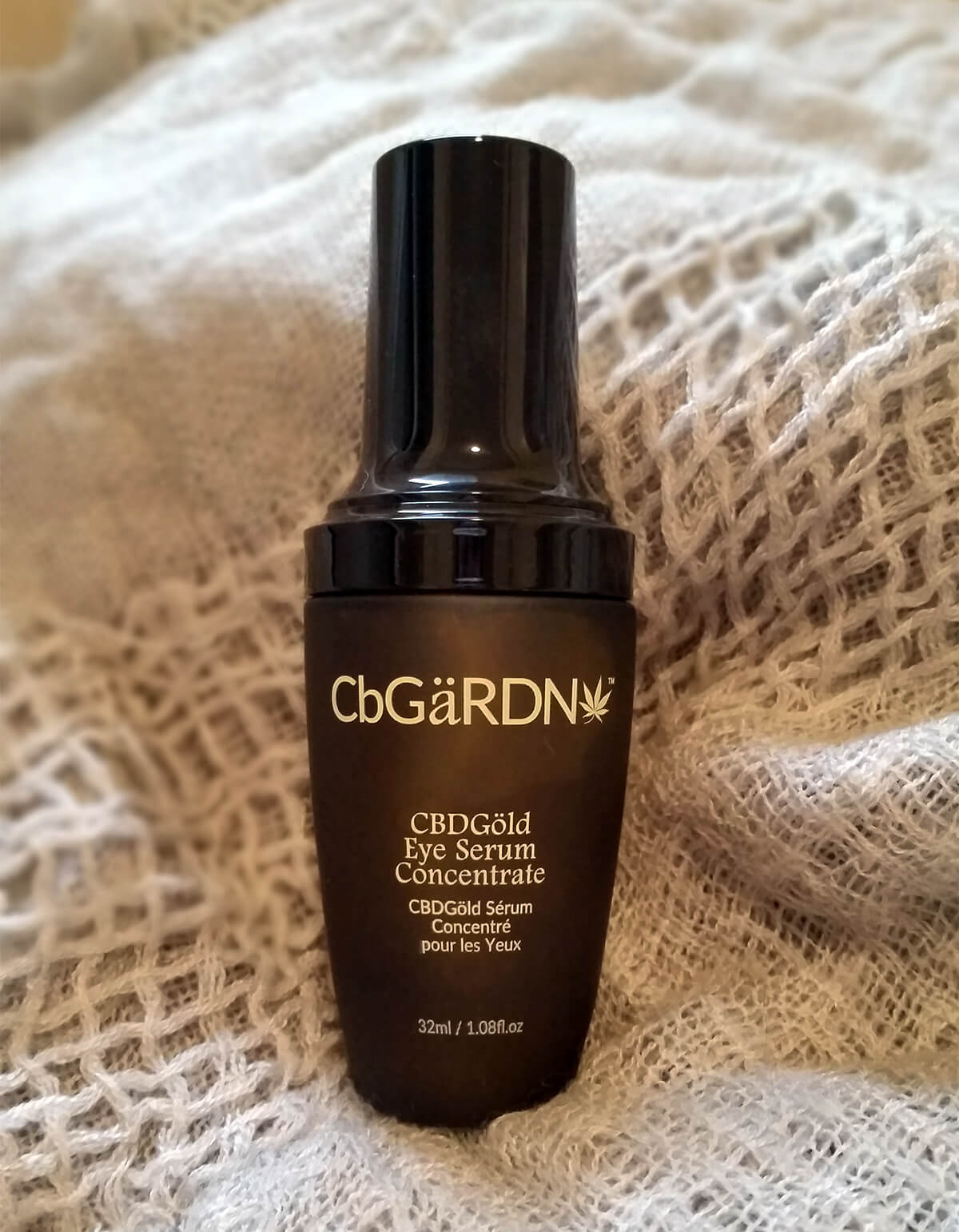 CBDGold Eye Serum Concentrate in bottle on blanket