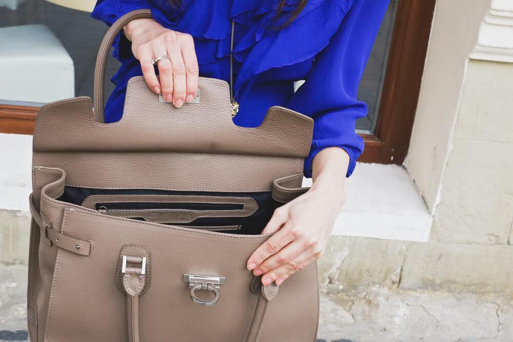 Woman looking inside handbag