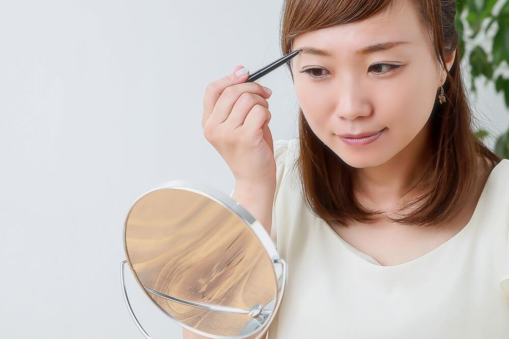 Woman applying brow makeup