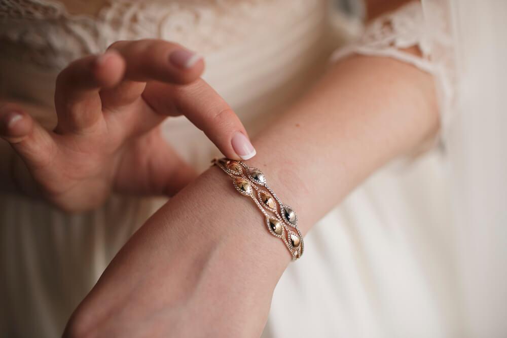 Woman touching bracelet on wrist