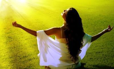 Woman meditates in sun