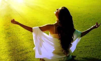 Woman meditates in sun