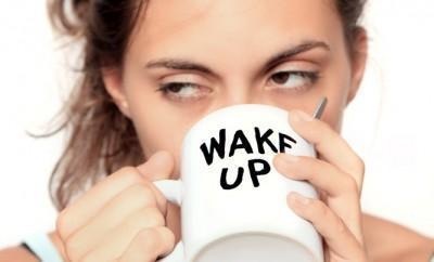 Tired woman sips coffee
