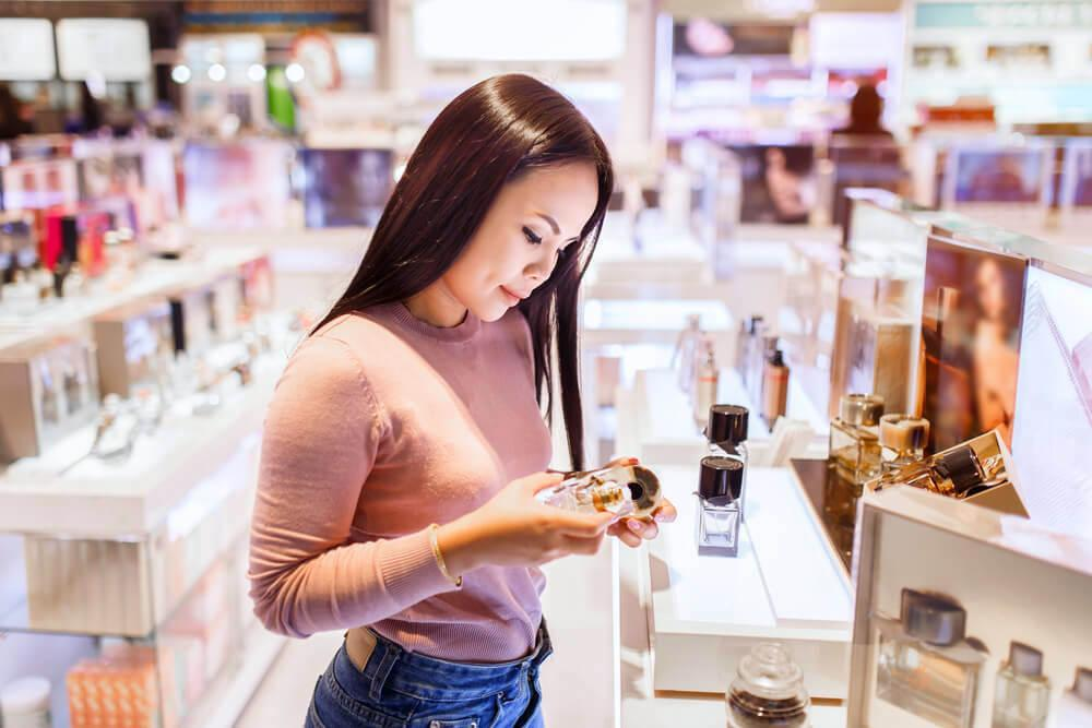 Young woman picking out skincare