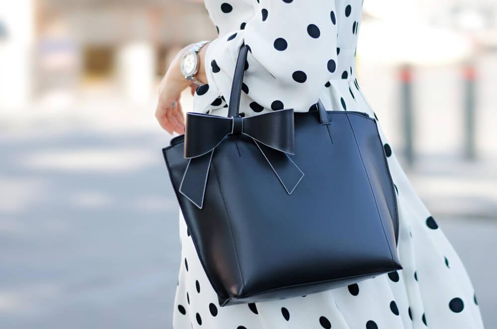 Woman with handbag and polka dot dress